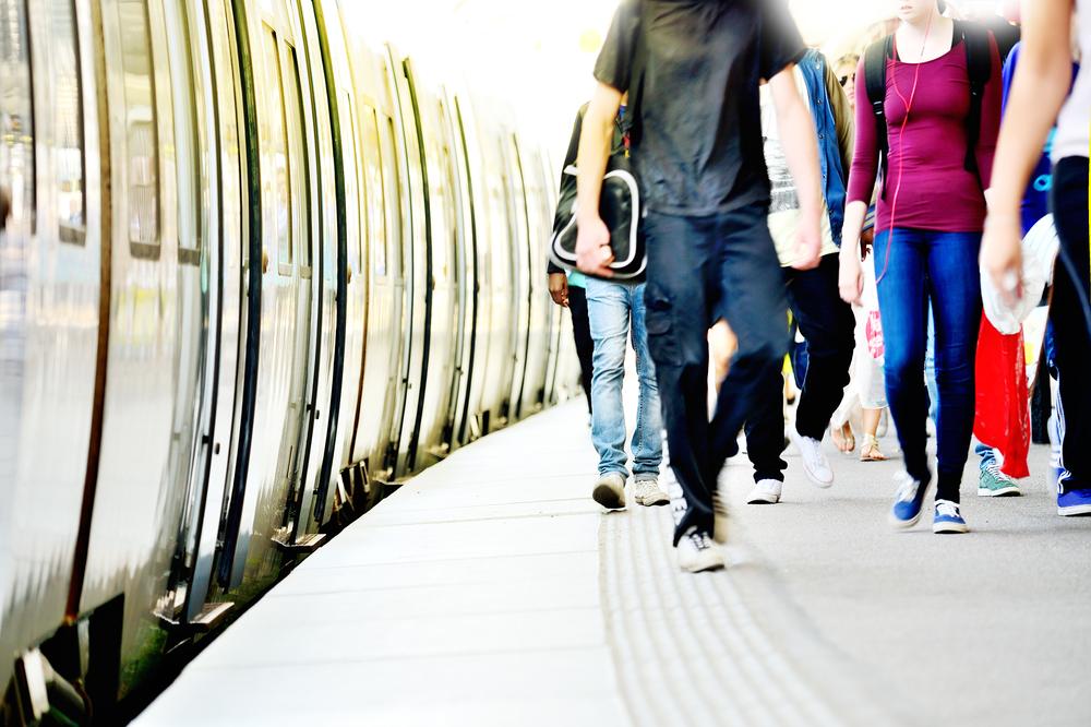 people walking on train platform